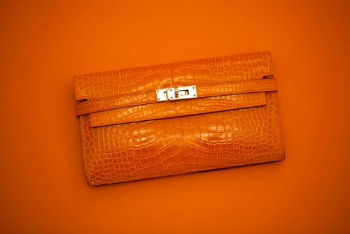 Hermes Kelly Wallet in Orange Alligator (pic from Purseblog)